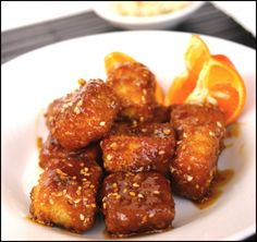 Baked panko crusted tofu tossed in a tangy orange glazed and sprinkled with roasted sesame seeds