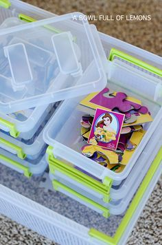 Organizing the playroom - A Bowl Full of Lemons using plastic bins with locking lids to hold puzzles. A great way to organize all sorts of toys!