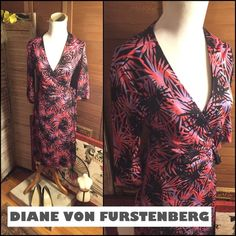 """FIRM🌺SZ 4-DIANE VON FURSTENBERG SILK WRAP DRESS CLASSIC SILK SZ 4-DIANE VON FURSTENBERG WRAP DRESS. BLACK/RED/BLUE SPLASH PRINT. IN GREAT CONDITION. ONLY FLAW ( SHOWN) A FEW INTERIOR SPOTS WHERE BLACK COLOR SHOWS ON INTERIOR. EXTERIOR SHOWS NO WEAR! ADJUSTABLE DUE TO WRAP. 3/4 SLEEVES 15"""" LONG. ABOUT 39"""" LONG SHOULDER TO HEM. MEASUREMENTS FLAT : BUST 16""""; WAIST 14""""; HIPS 17.5"""" AT WIDEST PART. COMFORTABLE AND CHIC DRESS. RETAIL $489. Diane von Furstenberg Dresses Midi"""