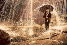 Josell Mariano created this incredible scene by igniting steel wool and allowing it to rain sparks of fire. Pretty awesome!