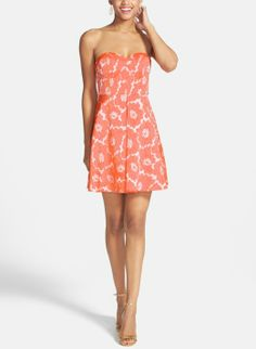 The perfect dress for date night! Love the orange print on this strapless fit  flare dress.