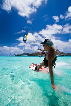 turquoise ocean summer sea girl kite kitesurfing surfing air water clear deep sun clouds bluew white hat cap hand smile happy relax chill extreme sport