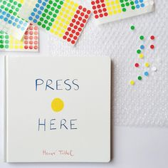 Press Here by Herve Tullet - A Busy Bag version of Press Here with Bubble Wrap + Stickers. www.acraftyliving.com