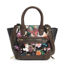 "Dolce Girl floral print crossbody satchel Dolce Girl by Dolce Vita floral print faux leather satchel with removable crossbody strap. A lush floral print and tough zipper teeth hardware make this compact satchel perfect for pairing with the season's trendiest looks. Rolled top handles, zip top closure, exterior zip pocket, interior zip, wall and smartphone pockets. Lined, material is polyurethane. Approx. 7.5"" W x 8"" H x 4"" D. 4"" strap drop, 14"" - 25"" crossbody strap drop. Purchased at…"