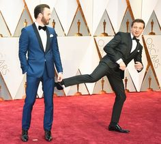 Chris Evans, left, and Jeremy Renner arrive at the Oscars on Sunday, Feb. 26, 2017, at the Dolby Theatre in Los Angeles.