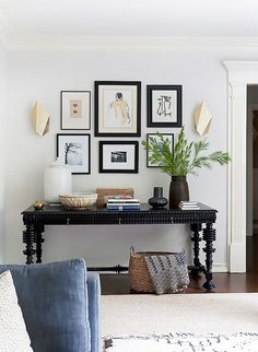 Living room with a small gallery wall and gold sconces