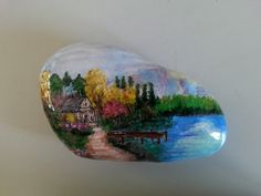 PAINTED STONE...A gorgeous scene painted on a rock!