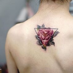 Beautiful flower inspired Triangle Glyph Tattoo design. The triangle encloses a pink flower in full color. While the parts of the flower outside of the triangle are in grayscale.