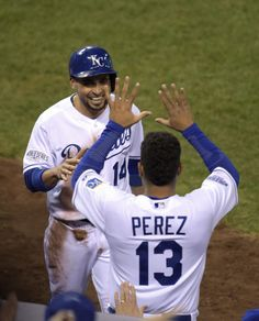 Royals second baseman Omar Infante (14) celebrates with catcher Salvador Perez (13) after scoring a run against the San Francisco Giants in the fifth inning during game six of the 2014 World Series at Kauffman Stadium. (Christopher Hanewinckel-USA TODAY Sports