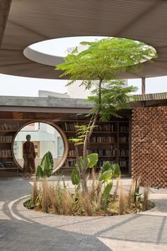 Mexican architect Daniela Bucio Sistos has created a red brick and coloured concrete house in Morelia, Mexico, that features round windows and a disc-shaped canopy over a courtyard.