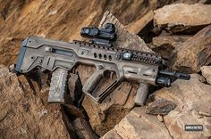 IMI Tavor Custom: Giessele Automatics Super Sabra Trigger Pack with Lightning Bow Trigger - Gearhead Works Tavor Modular Forearm w/ Integrated ELZETTA BRAVO 2-Cell Light, GHW Razorback Rail System, GHW Flex Swivel Plate - Leopold Mark 4 HAMR - * Silencerco Omega Suppressor - * 300 BLK Barrel