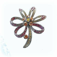 Star Flower Pin Brooch Swarovski Crystals Jewelry Pink Yellow Amber Art Deco ... Dazzlers. $27.50. Exquisite, limited edition item which is sure to grow in value over time.. Arrives In Padded Presentation Box With Certificate Of Authenticity. Bonded Seller, Stocked On Site, Quick Delivery & Gift Wrapping is optional.. Each pin is hand set with Sparkling Swarovski Crystals & hand enameled.. 100% Satisfaction Guaranteed Or Your Money Back