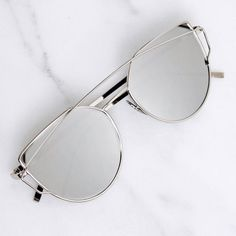 Silver Cateye Mirror Sunglasses A must have for unique sassy sunglass lovers! Love these so much I kept a pair for myself.  Brand new - no tags. Silver metal sunglasses with silver mirrored lenses. With metal temples and nosepads. Price is firm. SLVC04161. Photos are my own.  ❌No trades ❌No PayPal ❌No asking for the lowest price Accessories Sunglasses