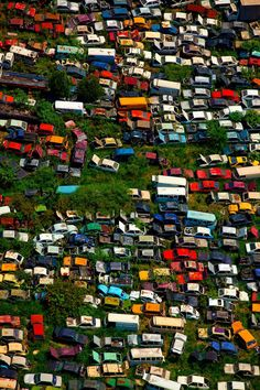 ...colorful junk yard, by Renato Stockler...