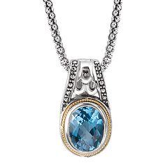 #741164. Oxidized sterling silver oval faceted blue topaz pendant with 18kt yellow gold detail.  Contact us for more information @ http://carmouchejewelerslaplace.com/