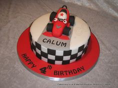 Roary Cake. Roary the racing car novelty themed cake finished in red and white with a chequers surround