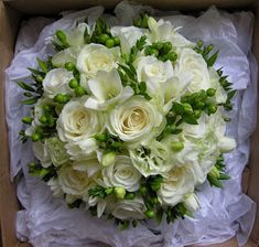 Roses Avalanche and Akito, freesia, pale green double lisianthus, green hypericum and the delicate berried myrtle.