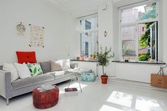 It's difficult to believe how spacious this tiny studio apartment feels. I'm certain it's all due to the high ceilings and a wall of enormous south-facing windows in the dual purpose living room and bedroom. The thick exterior walls create deep window wells. Topped with black marble, these built-ins are perfect for display or as …