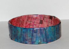 Paper Bangle Bracelets- Tutorial    I'm really excited about these super easy upcycled paper bangles because there are so many possibilities for them, using a strip of paper for the outside I could put images or type a quote using one of my typewriters on it. They are made very easily using things would normally be thrown into the recycling bin and a new kind of paint