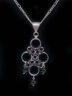 This ornate chainmaille pendant is made from over 70 individual aluminum jump with glass bead accents. Extreme detail and care is used in the closing of every ring to ensure it will not snag or scratch your skin or clothing. I only use the best quality rings that are proudly made
