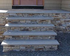 Bluestone steps.  I like meshing a little rustic with some clean, modern lines. (from earthmaterials.com)