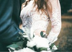 modest wedding dress with long lace sleeves and a flowing skirt from alta moda. -- (modest bridal gown) --