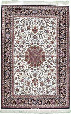 This Authentic Persian Isfahan rug is hand-knotted of Silk & Wool and has 520 knots per square inch.  #HandKnottedpersianrugs #rugs #persionrugs
