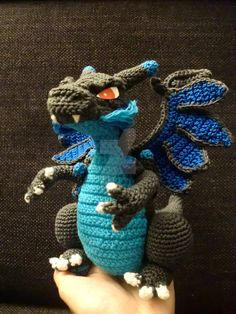 Used this -> www.miahandcrafter.com/atelier… great pattern and add and changed details (and also the wings x_x) for the Mega Charizard X.