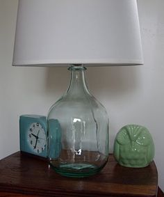 wine bottle lamp!!! Buy a large bottle of Livingston wine and an $8 lamp kit at Lowes. Love the light and airy look of a glass lamp.