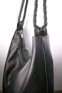 This large leather tote is designed with simple lines. It is feminine and strong. A hobo bag that has a generous amount of room for you to carry all your daily necessities and much more. It has one large exterior zipped pocket on the front of the bag and two inside. The outside zipper features a handmade leather tassel with a turquoise stone. The strap is hand braided leather. Handmade by me using extremely strong and fine Italian leather and lined with a durable fabric inside. The leather…
