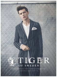 Tiger of Sweden has a soft spot for Adrien Sahores. The French model reunites with the Swedish brand following its pre-spring 2015 campaign. Starring in the latest advertisement of the label, Adrien is a chic vision as he sports modern suiting and stylish, comfortable basics. In addition to must-have eyewear, Tiger of Sweden's suits are front and center with pinstripes and broken lines for a ...