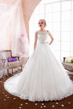 This gorgeous wedding gown holds in itself the essence of victorian beauty, allowing you to hold yourself with maximum poise.  Its classic cut is complemented by bead and imitation pearl applique, adding a distinct glow. The short corset highlights your perfect posture, and the delicate straps show off your feminine features. The voluminous skirt with a lace hem makes your look weightless, and the stunning train add a majestic finishing touch.  Capture everyone's heart as you make yo...