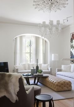 Living Room with tufted camel ottoman
