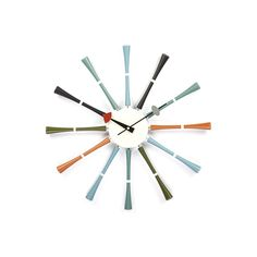 Randomly colored wooden spokes mark the hours on this Spindle wall clock. They are mounted on a metal housing with its high quality Quartz movement (requiring only one AA battery; not included). Size: