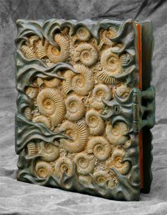 Fossil Book cover (sculpture and paint) by Tim Baker Leather Book Covers, Leather Books, Polymer Clay Creations, Polymer Clay Art, Book Sculpture, Sculptures, Photo Sculpture, Altered Books, Altered Art