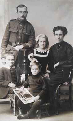 WW-I-British-Real-Photo-Postcard-A-British-Army-Pipe-Major-with-His-Family