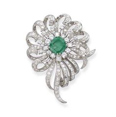 AN EMERALD AND DIAMOND BROOCH   The central rectangular-cut emerald within a stylized floral border of baguette, single and brilliant-cut diamonds, with black leather case