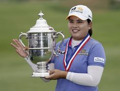 Inbee Park, of South Korea, holds the championship trophy after winning the U.S. Womens Open golf tournament at the Sebonack Golf Club, Sunday, June 30, 2013, in Southampton, N.Y. Park has won the U.S. Womens Open to make history with titles in the years first three majors. (AP Photo/Frank Franklin II) NYFF137