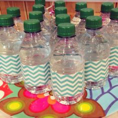 My daughter's cat-themed 8th birthday party.   Tiny bottled waters (labels removed and wrapped in patterned duct tape). The color matched the tablecloth but I honestly just had the duct tape left over from a boy baby shower I threw last fall and I was too cheap to buy the paw print duct tape I found for $8. 7th Birthday Party Ideas, 8th Birthday, Birthday Parties, Label Removing, Lil Sis, Kittens, Cats, Duct Tape, Baby Boy Shower