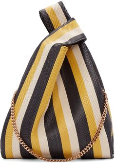 Woven wicker tote bag striped in black, yellow and nude. Twin carry handles at top. Curb chain shoulder strap with logo disk. Zippered pockets at interior. Black textile lining. Gold-tone hardware. Tonal stitching. Approx. 13
