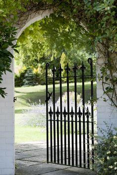 Wall in Farrow & Ball's Wimborne White Exterior Masonry paint. Gate in Off-Black Full Gloss