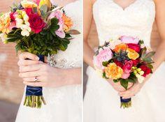 Colourful bouquet. Red, orange, pink bouquet. Lethbridge wedding. Southern alberta wedding. White lace dress. Roses. Kinsey Holt Photography. Blooms Flowers & Gifts Lethbridge. Lethbridge florist.