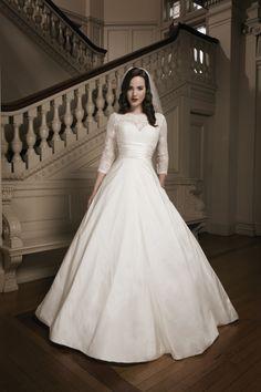 Three-quarter lace sleeves. (Justin Alexander) You guys I think that I found my wedding dress!