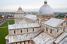 The marble cathedral of Pisa and the Baptistery, Tuscany, Italy.
