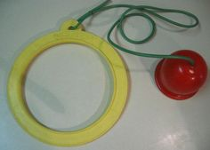Do you remember Footsie?   You put the yellow ring around your ankle and made it go in circles, jumping over the rope and bell.  It was a simple toy but fun!