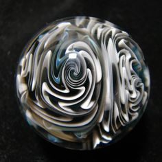 an inside out sealed hollow borosilicate glass marble by Andrew Groner.