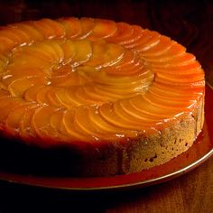 Poached quinces turn a beautiful rosy color, which make a stunning top to the cake when arranged in concentric circles.