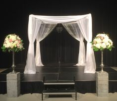 The 8 x 8 all sheer chuppah with string curtain accents and chandelier by www.Chuppah.ca