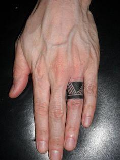 Minimal Black Tat On Finger