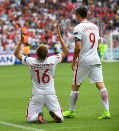 Poland's midfielder Jakub Blaszczykowski celebrates scoring the opening goal next to Poland's forward Robert Lewandowski during the Euro 2016 round.